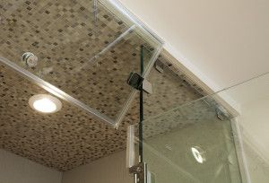 This contemporary steam shower in Bryn Mawr, PA features custom glass with a vent flap.  LED lighting was installed in the shower.