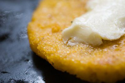 Hot Water Corn Bread - 2C yellow cornmeal in bowl.  Sprinkle top with salt.  Pour BOILING water over mixture and stir with spoon until it resembles soft mush.  Take heaping tablespoon, make a patty and drop into hot oil (cast iron skillet).  Flip when golden.