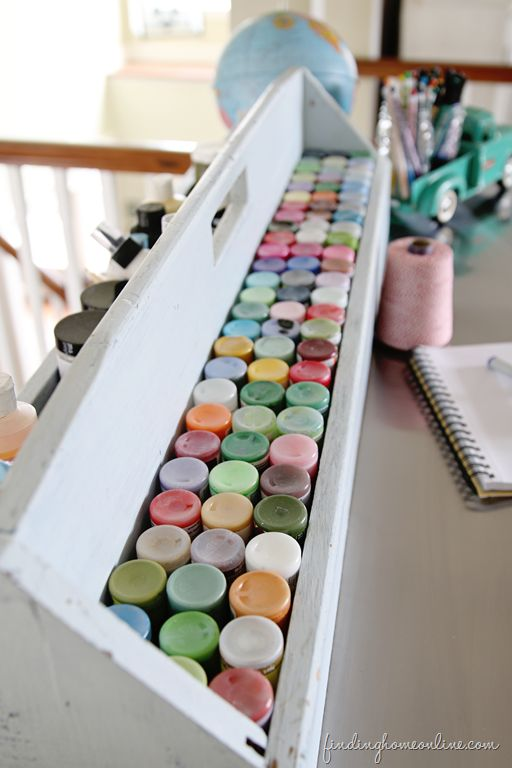 What a great way to store paints! Ikea Hack Craft Table (& Craft Paint Storage!) - Finding Home