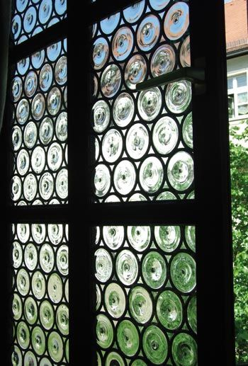Rondel Windows - traditional blown glass windows in the style commonly found in the Middle Ages