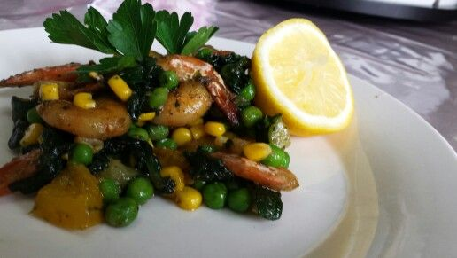 Just sauté veggies of your choice and shrimp and season with salt, pepper and italian spices. When done, defrost peas and corn and add to mix and voilà!