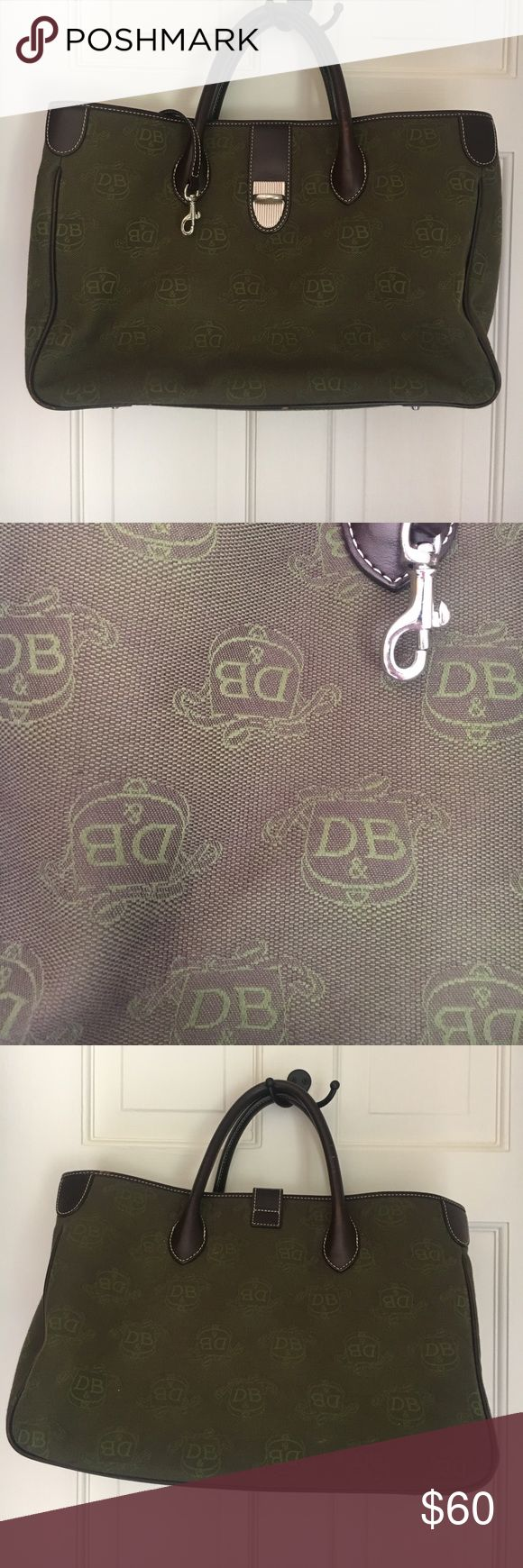 """Dooney and Bourke Tote Like New only used a few times and has no signs of wear. Beautiful green with DB shield. Removable shoulder strap with make up case and eyeglass case included. Very roomy with 2 large compartments divided by a center zip compartment, Key fab attachment, 2 cell pockets and an interior side zipped pocket.  14"""" L x 9"""" H x 6"""" W Dooney & Bourke Bags"""