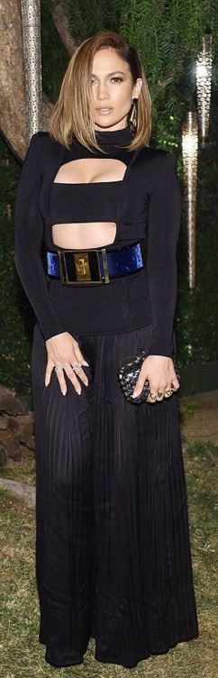 Who made  Jennifer Lopez's black pleated pants, cut out top, and blue belt?
