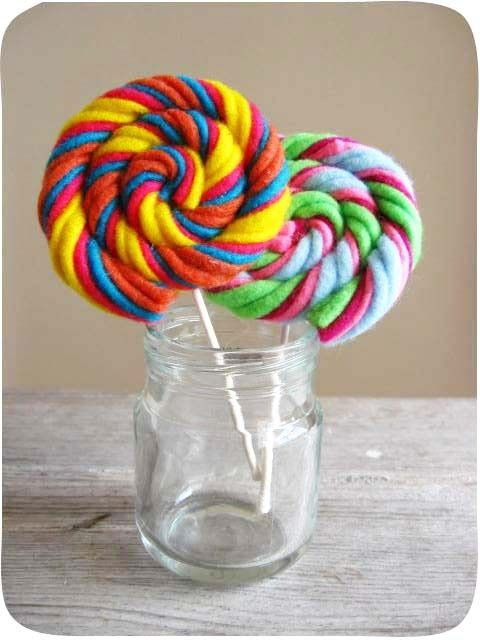felt/yarn lollipoptotally doing this for a little girls bedroom! Can you say lollipop princess?