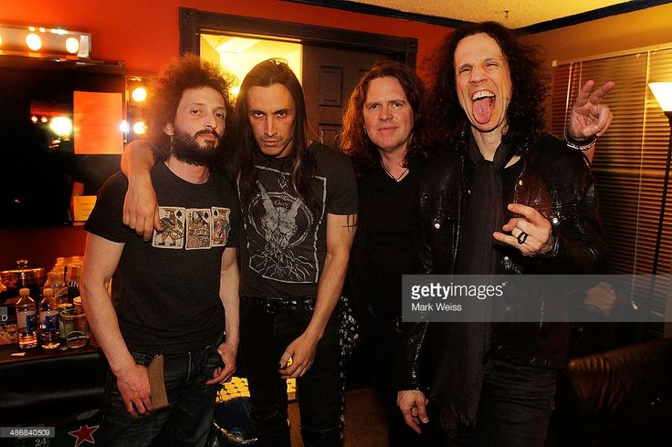 Kevin Figueiredo, Nuno Bettencourt, Pat Badger and Gary Cherone from Extreme pose backstage at the 2014 M3 Rock Festival at Merriweather Post Pavillion on April 25, 2014 in Columbia, Maryland.