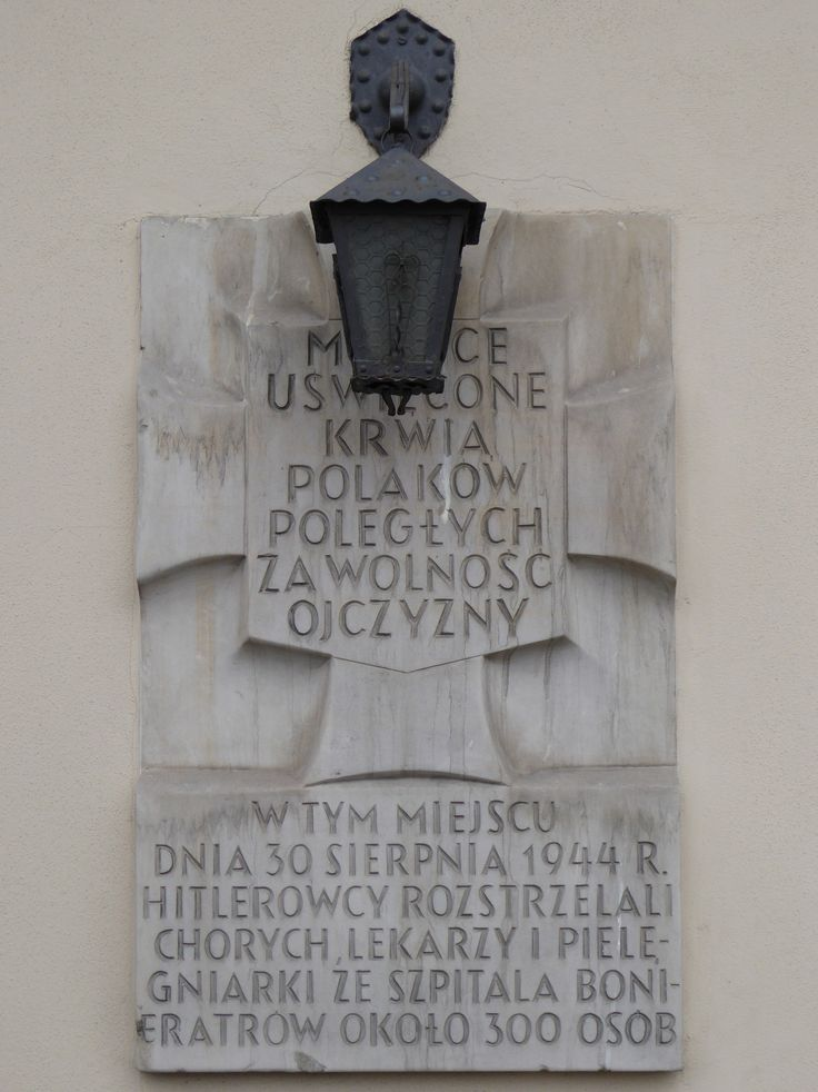 """A """"Tchorek plaque"""" on the wall of the Church of John the Baptist (Kościół Jana Bożego). The church was used as a field hospital during the Warsaw Uprising and on 30th August 1944 the Germans murdered 300 people here...."""