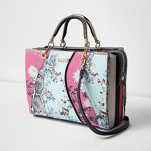 Mixed print wave design Double zip top fastening Crossbody strap Grab handles RI branding Height: 26cm width: 37cm strap length: 122cm