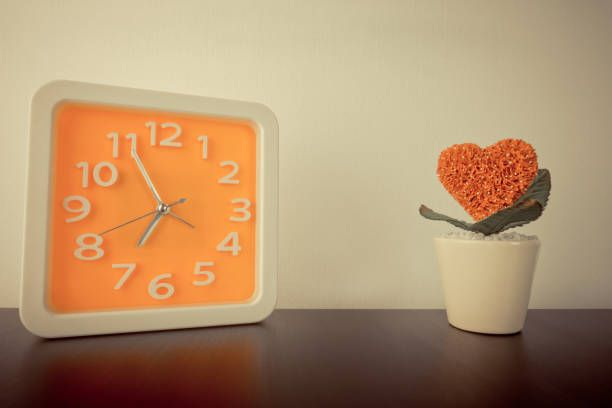 orange clock with heart flower pot in vintage tone