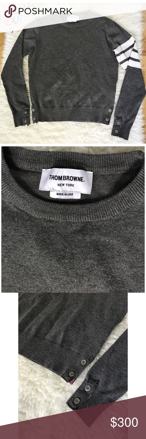 """Thom Browne Classic Striped Sleeve Buttons Sweater Still in great pre-loved authentic classic Thome Browne sweater in size 0, like a size x-small.  No major flaws except the the buttons on the right sleeevs have cracked but still can Button Up. See 7th pics above for detail. No major pilings/snags. Measure about 20"""" length, 17"""" pit to pit, about 22.25 sleeves. Still selling similar style on high end dept stores for ice $1300. ❌No trades or modeling. Open to reasonable offers. Bundle and save…"""