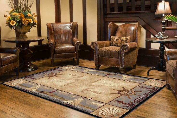 Universal Rugs Novelty Lodge 5 ft. 3 in. x 7 ft. 3 in. Area Rug, Beige.  This nautical themed area rug has anchors, sailboats, shells, and lighthouses.