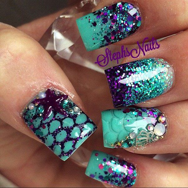 Paint the colors of the sea unto your nail with help from glitter nail art designs and add wonderful accents like starfish and scale details to complete the look.