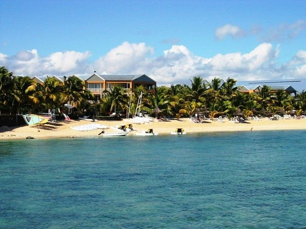 Le Victoria Hotel, Pointe aux Biches, Mauritius — by The Whites Blog. A great hotel, beautiful beach and clear water.
