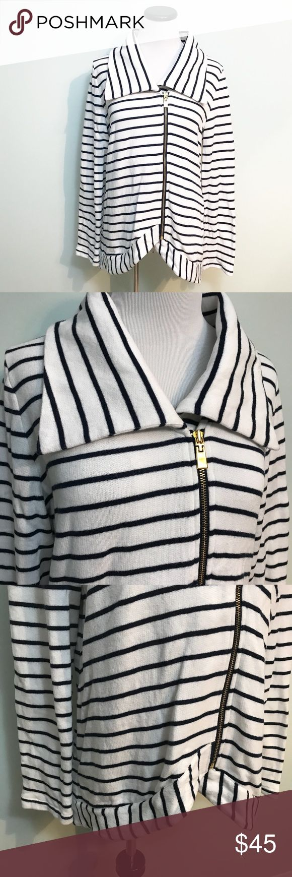 "TOMMY HILFIGER Navy blue white zip up Jacket Tommy Hilfiger Navy blue and white striped zip up Jacket sweatshirt. Sweatshirt material. Gold colored zipper. Slight hi low design. Length in front 26"". Chest 21.5"". Side pockets. Big shawl collar. Tommy Hilfiger Jackets & Coats"