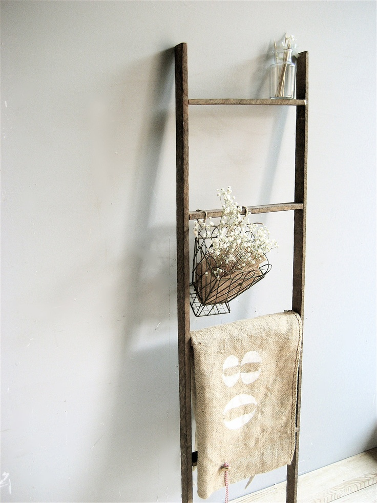 Primitive weather wood ladder.   Not heavy so is easy to hang, or it can lean against a wall. Great to use in the bathroom or in the kitchen.