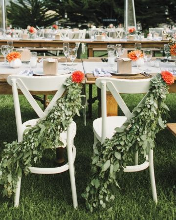 Eucalyptus garlands for the newlyweds' chairs