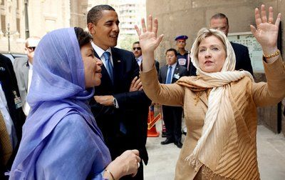 """HILLARY: """"I think Sharia Law will be a powerful new direction of freedom & democracy for the women of Libya. All my life I've fought for women's equality & NOW THAT I'M THE MOST POWERFUL WOMAN IN AMERICA, I'm proud to have brought about this change to the repressive Khadaffy regime in Libya...""""When reminded that Sharia law means complete & barbaric opression & enslavement of women, Clinton responded """"Isn't that the other one, the shiite thing?...READ MORE"""