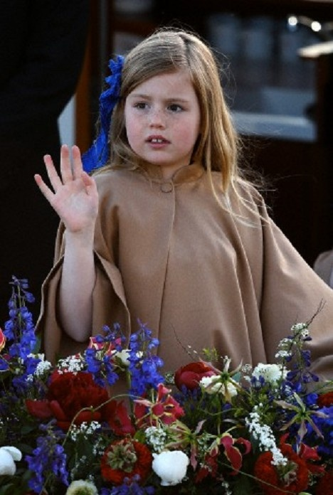 Dutch Princess Alexia waves to the crowd during a boat parade in Amsterdam 30 April 2013