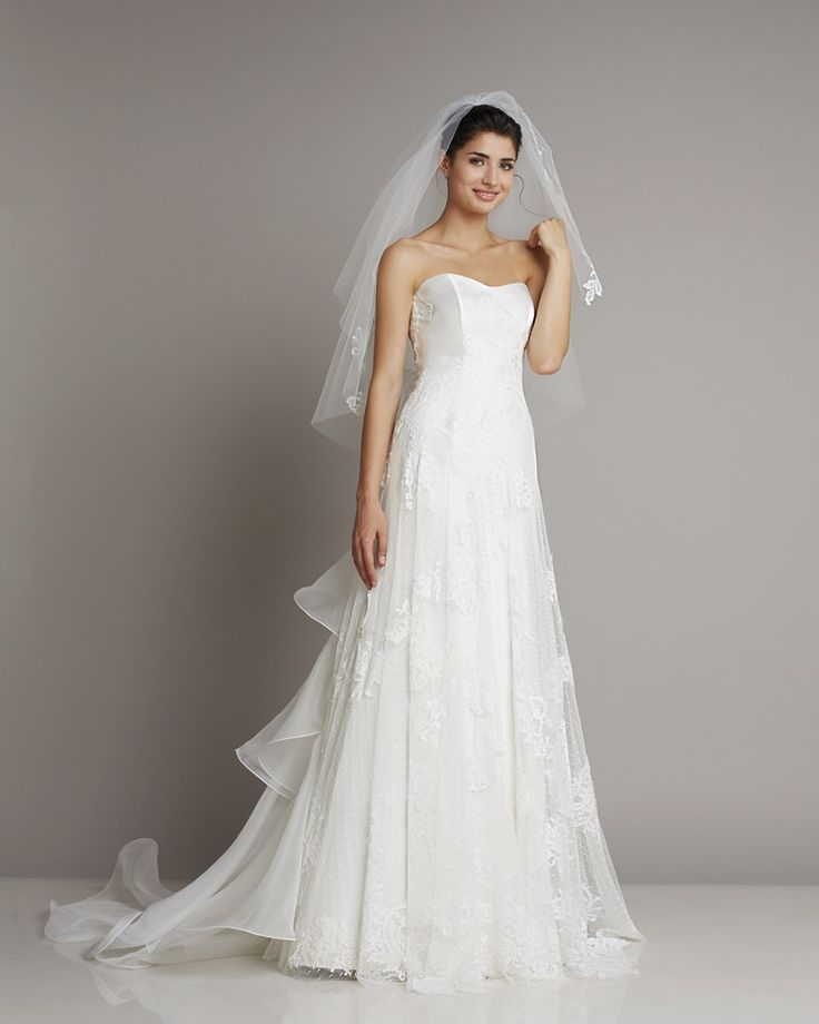 A-line wedding dress with sweetheart bodice, French lace and tulle skirt. Organdis train on the back adds a glamorous taste. The matching veil is the must-have accessory to complete the romance. www.giuseppepapini.com