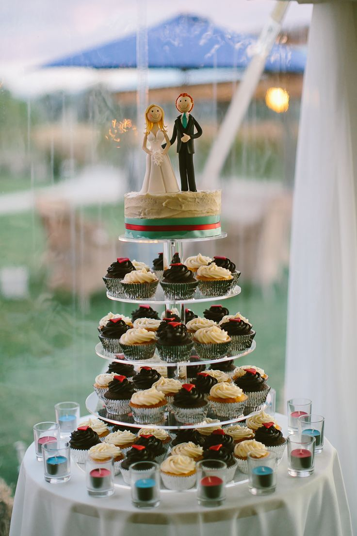 Cupcake tower wedding cake. Custom cake toppers. Image: Cavanagh Photography http://cavanaghphotography.com.au