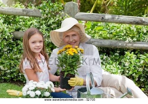 Grandmother with her granddaughter working in the garden Image by Wavebreak Media