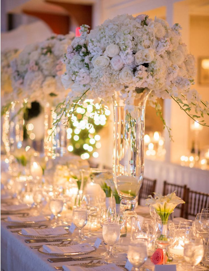 The candle-lit tables were set with a beautiful array of calla lillies, white garden roses, and gardenia.