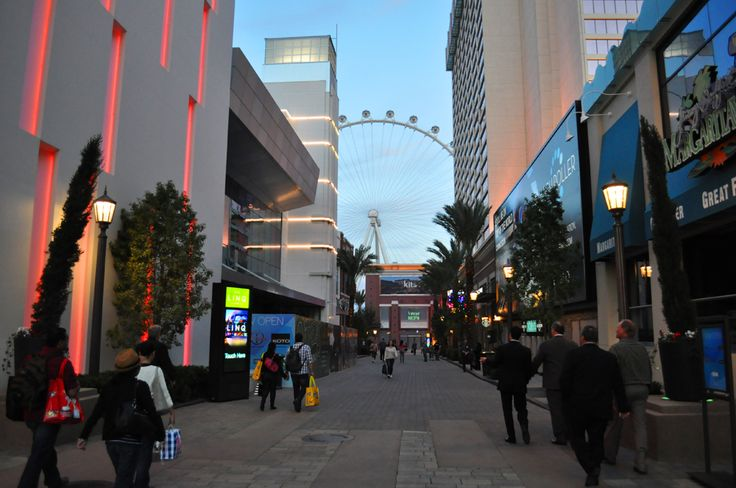 At 300,000 square feet and 70 percent given over to restaurant and bars, The Linq open-air entertainment district. The Linq forms a connection between the Flamingo Las Vegas resort and The Quad resort on either side and length ways from Las Vegas Boulevard down to the High Roller wheel. High end (meaning very expensive) it includes the High Roller Wheel a 550 foot ferris wheel