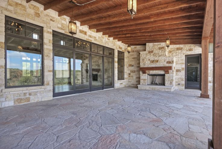 hill country fire place ideas | Our door living area. Pine ceiling, fir columns, stone fireplace ...