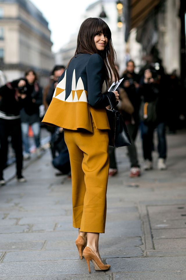Miroslava Duma, street style during Paris fashion week FW 2015, printed jacket, mustard pants and shoes.