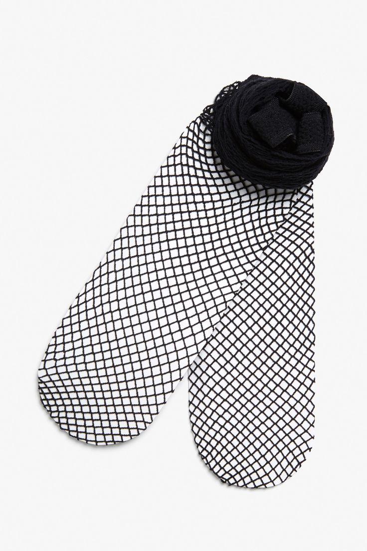 Monki Fishnet tights in Black