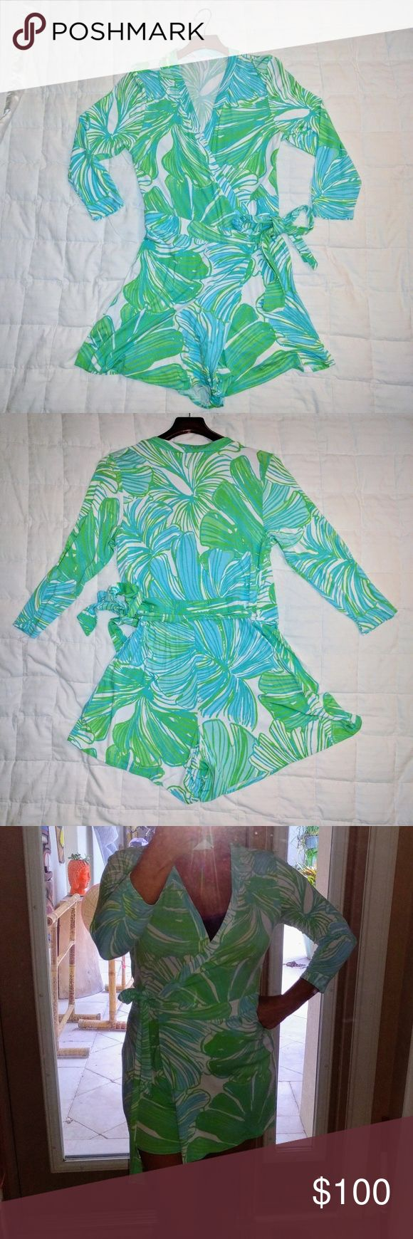 """Lilly Pulitzer Karlie Wrap Romper Sz Large Lilly Pulitzer Karlie Wrap Romper in Fronds Place. I never even wore it, took off the tags, handwashed it and it's been sitting in my closet. This romper is a light weight spandex jersey that is so flattering. Check out Lilly Pulitzer's website for reviews. 4.7 out of 5 hearts. Seriously well liked! 5"""" inseam. Lilly Pulitzer Dresses"""