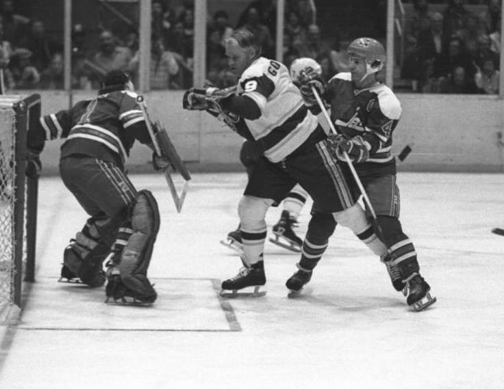 Lars Erik Sjoberg doesn't give an inch to Mr. Hockey who looks to set up camp in front of Joe Daley.