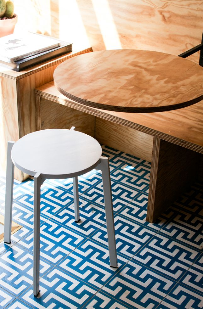 Bright blue floor tiles continued onto counter front- burst of colour and attracts the eye