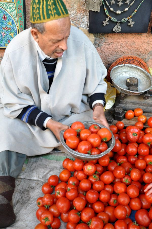 A tomato vendor in the souks of Marrakech. If you're in Morocco, make sure you spend some time getting lost in the souks - you'll see so many vibrant people, colours and trinkets!