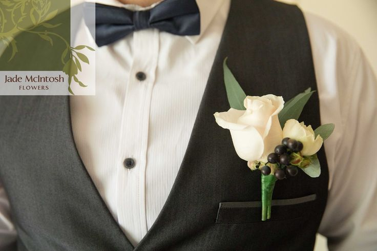 We love this oversized buttonhole of roses finished wiht green gum leaves and blue viburnum berry. www.jademcintoshflowers.com.au www.secheny.com