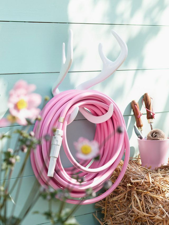 Pink garden hose and a cute antler hose holder!