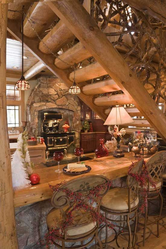 Great use of space under stairs in this log home.