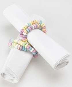 Edible Napkin Rings – Budget Wedding Planning uses inexpensive candy bracelets for their edible napkin rings. They also double as an edible favor.