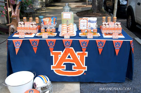 STYLING & PHOTOGRAPHY: AMY OF AMY'S PARTY IDEAS  |  PRINTABLE LABELS:  LULU COLE  |  CUPCAKE WRAPPERS TEMPLATE:  AMY'S PARTY IDEAS  |  FOOTBALL EDIBLE CUPCAKE TOPPERS:  WILTON  |  VINTAGE AUBIE CUPCAKE TOPPERS:  GOGO CAKE  |  AUBURN TABLECLOTH:  TEAM