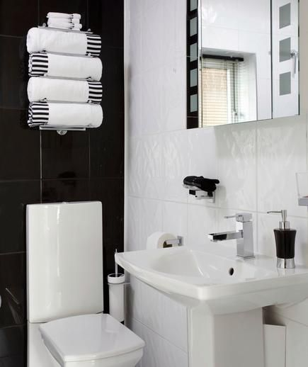 While a monochromatic black and white bathroom is contemporary, it's also invigorating.