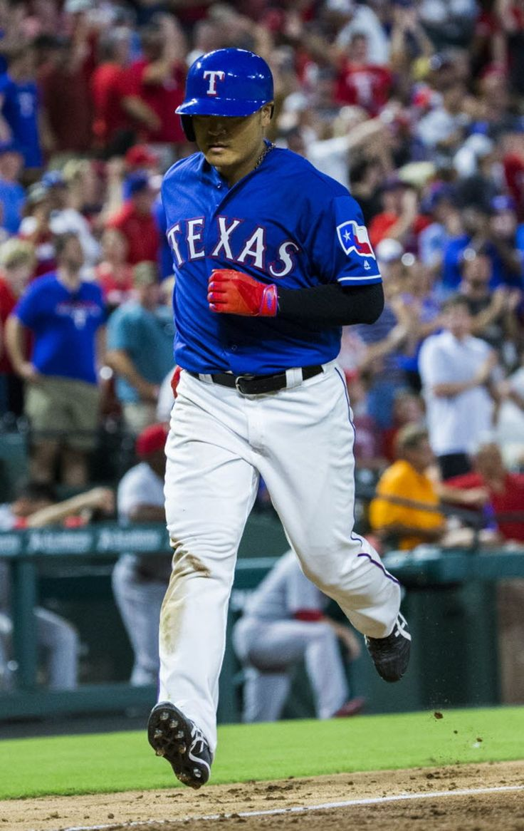 Texas Rangers right fielder Shin-Soo Choo (17) runs to home base after hitting a home run during the eighth inning of their game against the Cincinnati Reds on Wednesday, June 22, 2016 Globe Life Park in Arlington, Texas. The Rangers won 6-4. (Ashley Landis/The Dallas Morning News)
