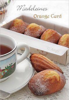 Les Madeleines à l'Orange Curd sont très moelleuses et délicieusement parfumées ! une variante très appréciée... Ingrédients 3oeufs 150 g de sucre 5 cuillères à soupe de lait 100 gr de beurre fondu 3 cuillères à soupe d'Orange Curd 200 gr de farine 1...