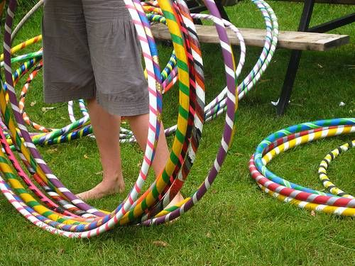 Outdoor party games for kids, maybe bean bag throw or fill up balloons, tie to something and have them pop them.