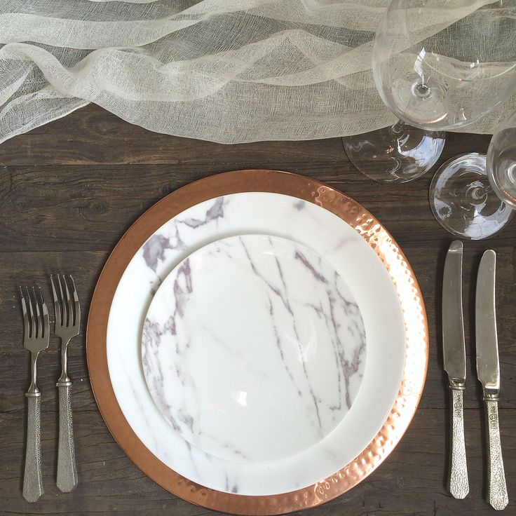 the ARK collection - Copper Charger / Carrera Marble Dinner & Salad / Hammered Pewter Flatware