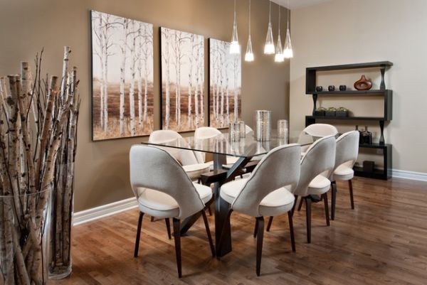 Tall glass vases with birch branches that blend  with the wooden flooring. Great chairs and wall colors