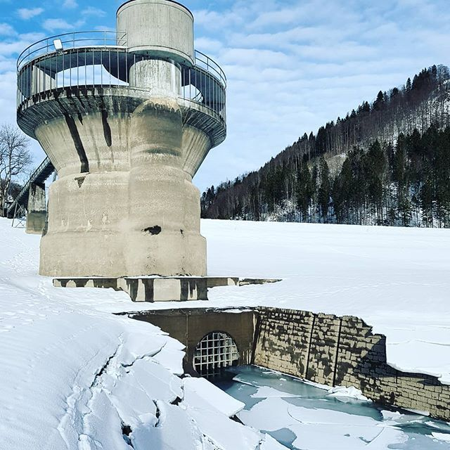 The spooky concrete monster in the dried out lake.  Have you seen this lake?  #nature #naturelovers #igerssuisse #instamood #instagood#picoftheday #lake #landscape #snow #clouds #trees #tower