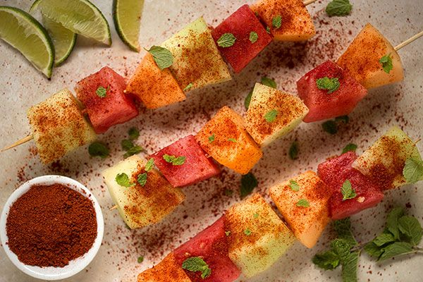Chile-Lime Melon Skewers: Fruit skewers sprinkled with chile powder and lime are a popular Mexican street food, and make for a healthy summer treat!