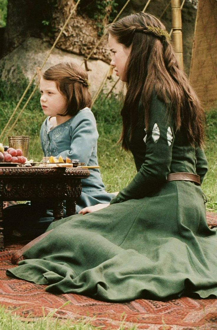 Susan and Lucy. Their costumes may not be as extravagant as ones from later Narnia movies, but I will always love their first Narnia costumes the most.