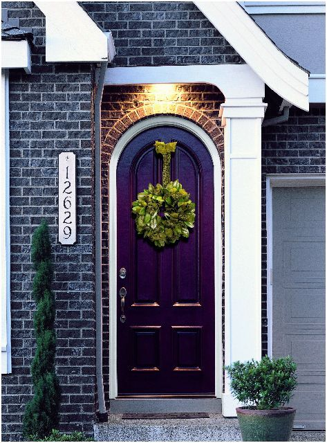 Plum Front Door -- pretty with the white trim and greenery