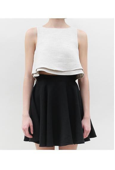 Flared white crop double hem blouse & black skirt.