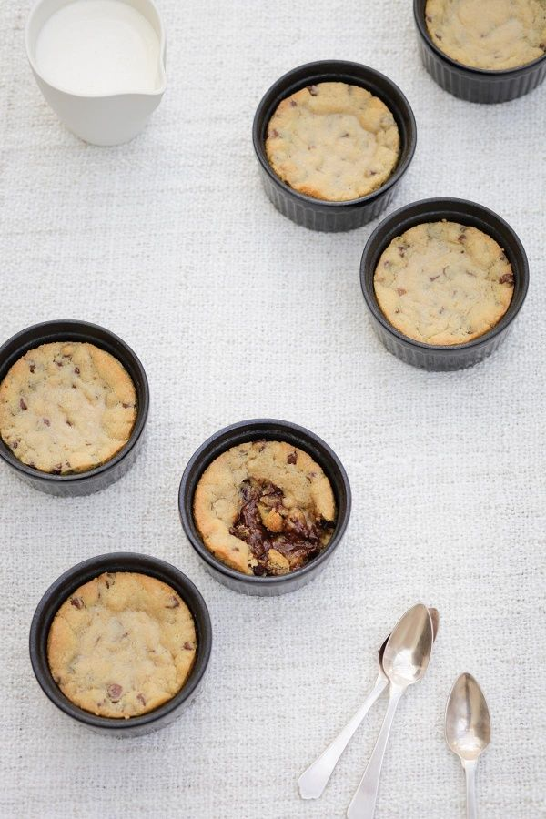 Chocolate Chip Cookie Dough Pots | Simply Novella | A warm chocolate cookie too gooey to hold its shape gets crispy edges baked in a ramekin. Delicious topped with vanilla ice cream #chocolatechip #cookie #recipe